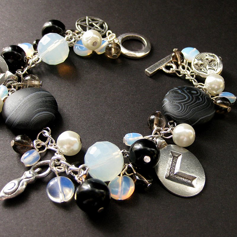 Mystic Runes Charm Bracelet by Gilliauna