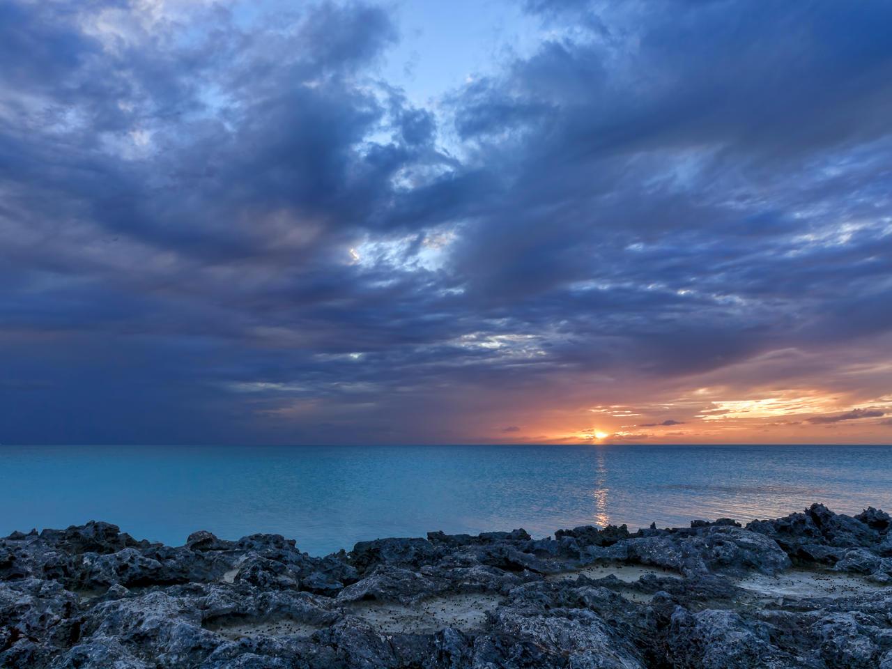 Half moon sunset by peterpateman