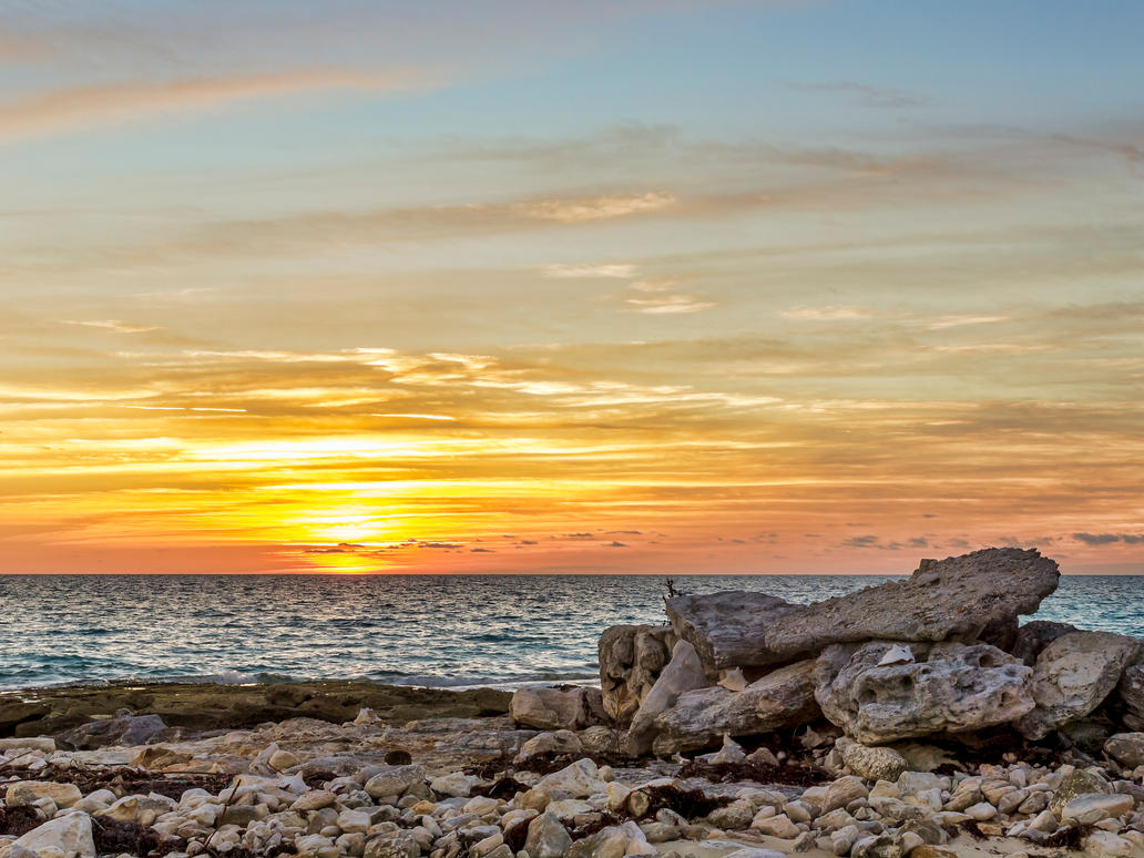 Rock pile sunset by peterpateman
