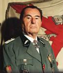 Leon Degrelle behind Wallon Brigade Flag