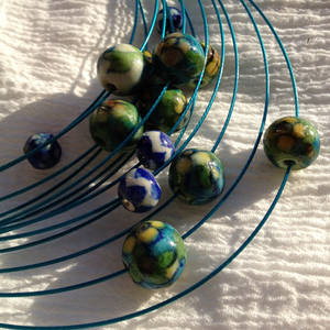 Traditional pottery beads on modern steel