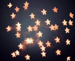 Orange Star Bokeh by bluezircon-graphics