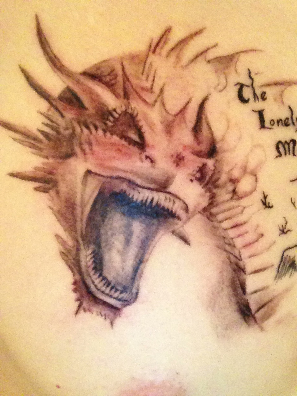 Another picture of Smaug tattoo by MattAmanda05