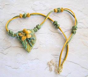 Golden Lily on Leaf necklace