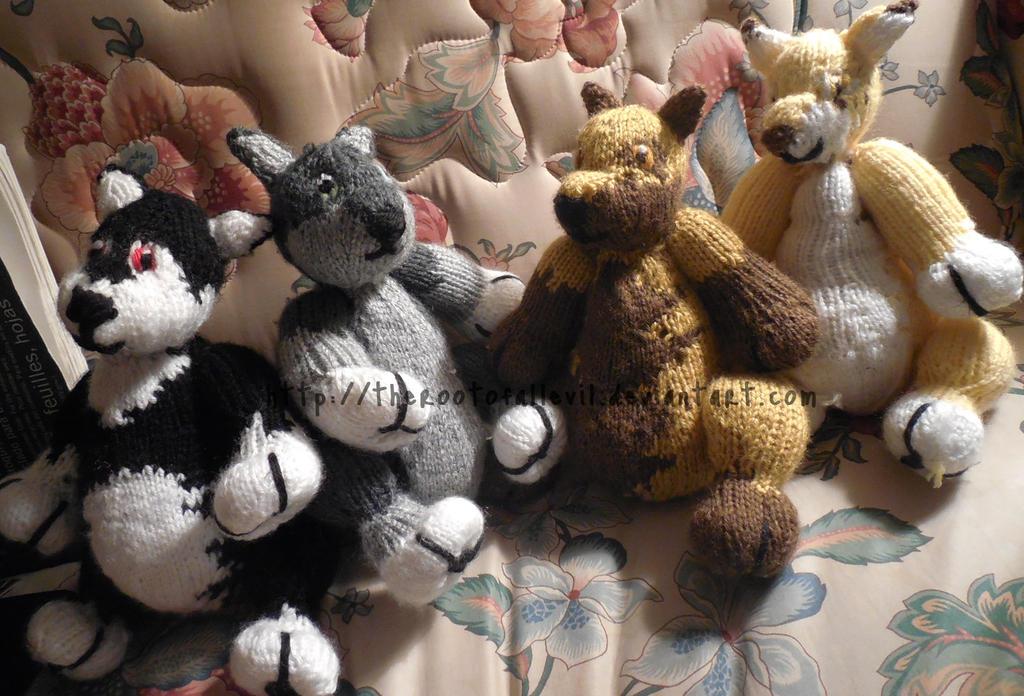 Rain, Os, Hitonomi, and Kekasui teddy wolves by TheRootOfAllEvil