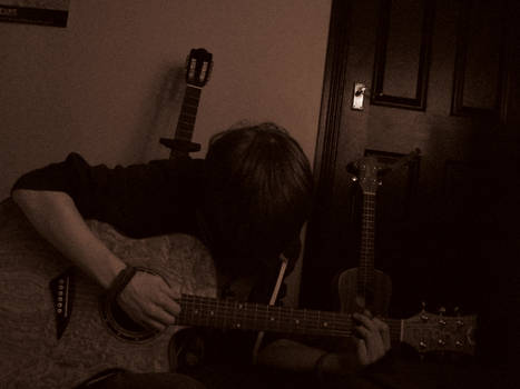 DRAMATIC PLAYING GUITAR SHOT