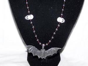Skull+ Bat necklace close up