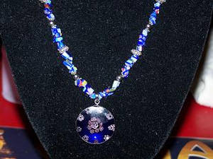 Close up of blue necklace