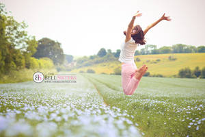 Jumping in a Flax Field by thesashabell