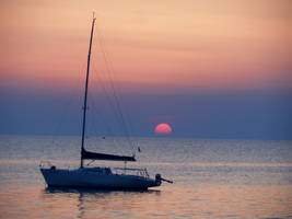 Boat under the setting sun by Paul774