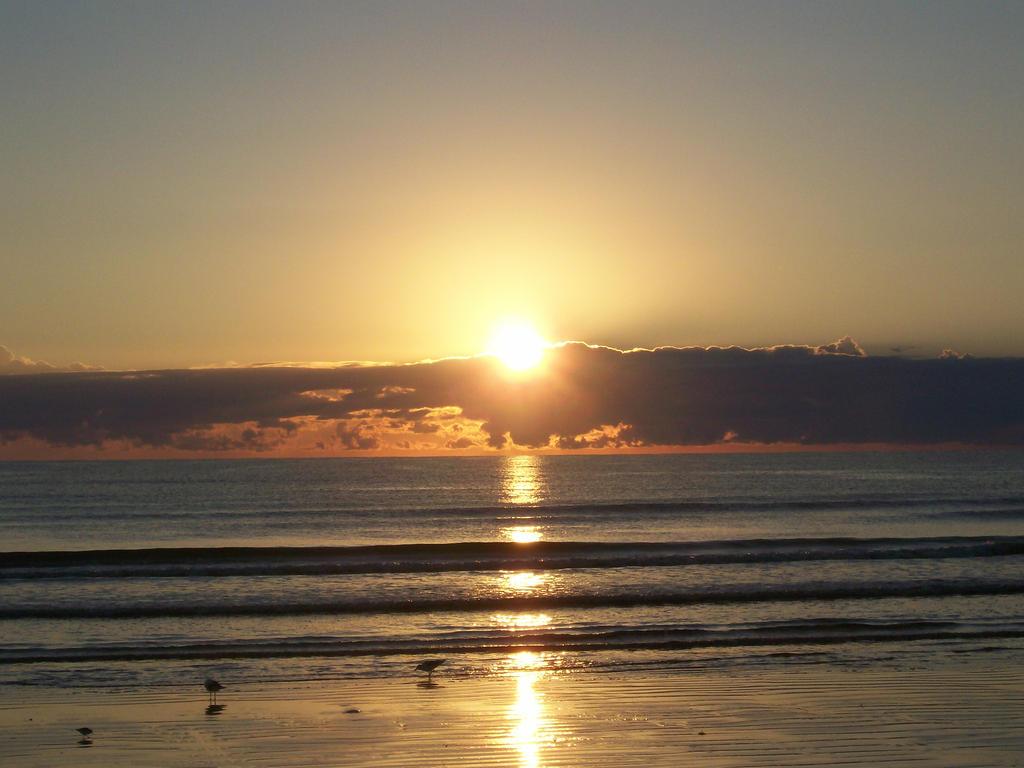 Sunrise in Cocoa Beach, FL by CmdrKerner