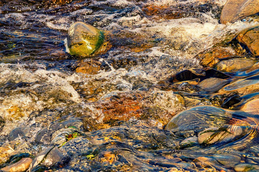 Water over rocks by Sakycake