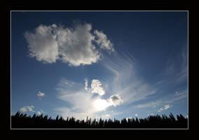 Blue sky, wisps of clouds by zironjones