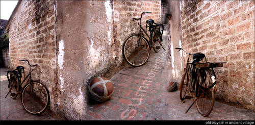Old bicycle in ancient village by summoner131