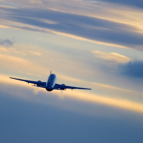 Commercial airplane in flight by gregbajor
