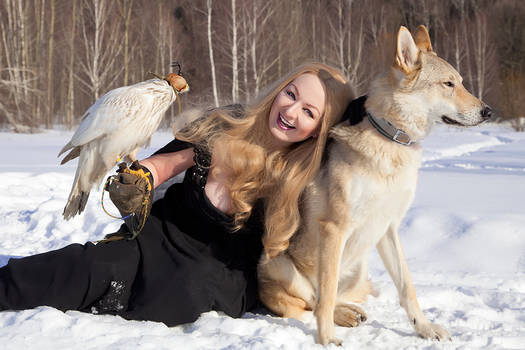 Pretty Cute Smiling Woman With Her Hawk and Wolf
