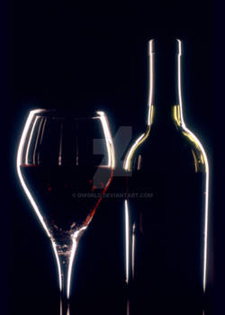 Wine Glass and Bottle Dramatic Lighting