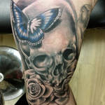 Skull and butterfly underarm tattoo