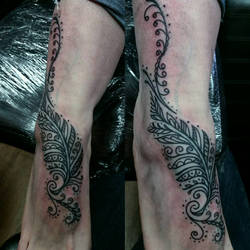 mendhi style feather foot tattoo