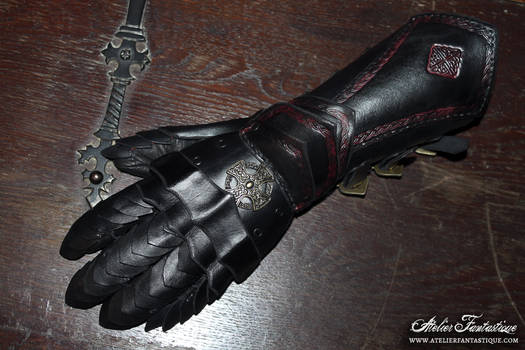 Dark red and black articulated gauntlet