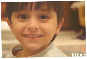 Tiny, little grin