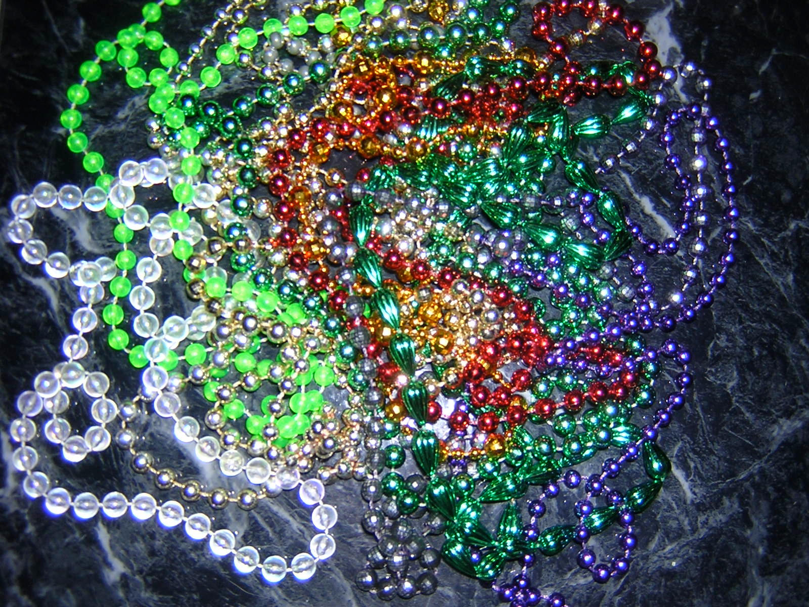 mardi gras beads by SkornedWolfe-stock
