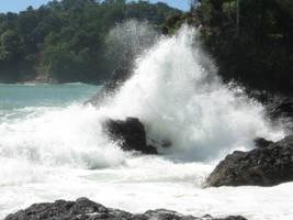 Waves on reef by NaturalBornCamper