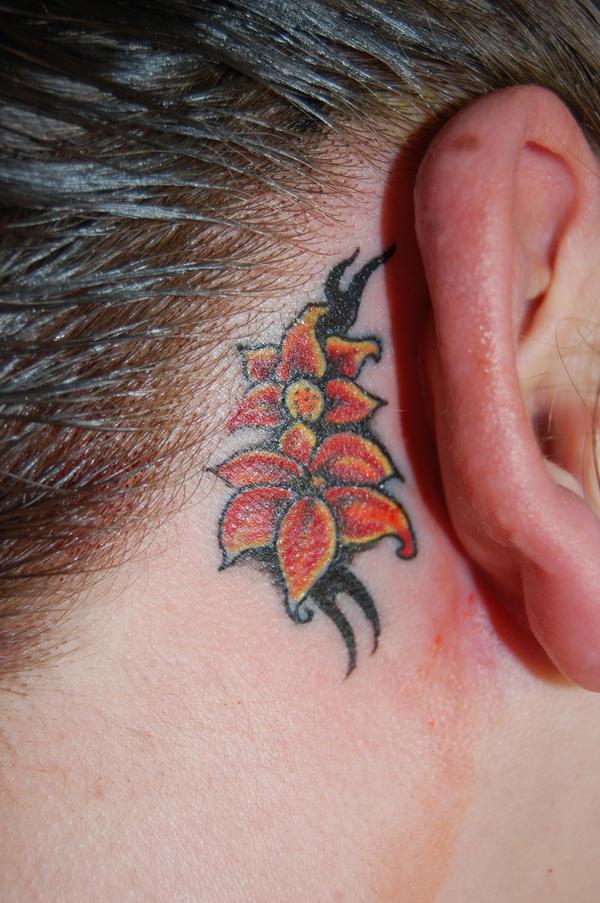 Flower ear tattoo