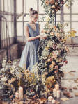 Girl in a dress with flowers and candles
