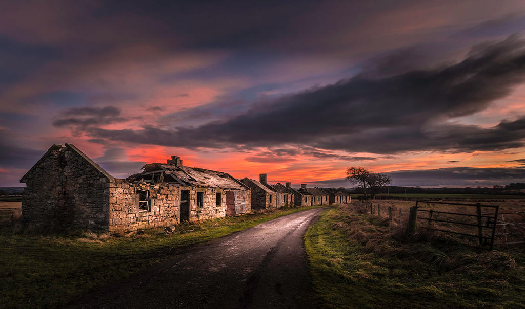 Old cottages during sunset by KlikitiKlik