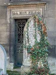 Grave stone with ivy unrestricted by DivsM-stock