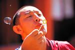 Monk blowing a bubble