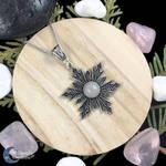 Snowflake necklace with a rose quartz gemstone
