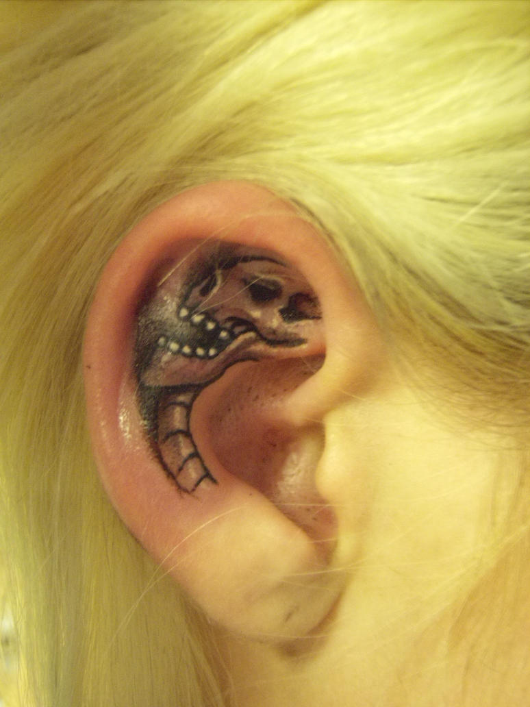 skull tattoo in ear by hatefulss