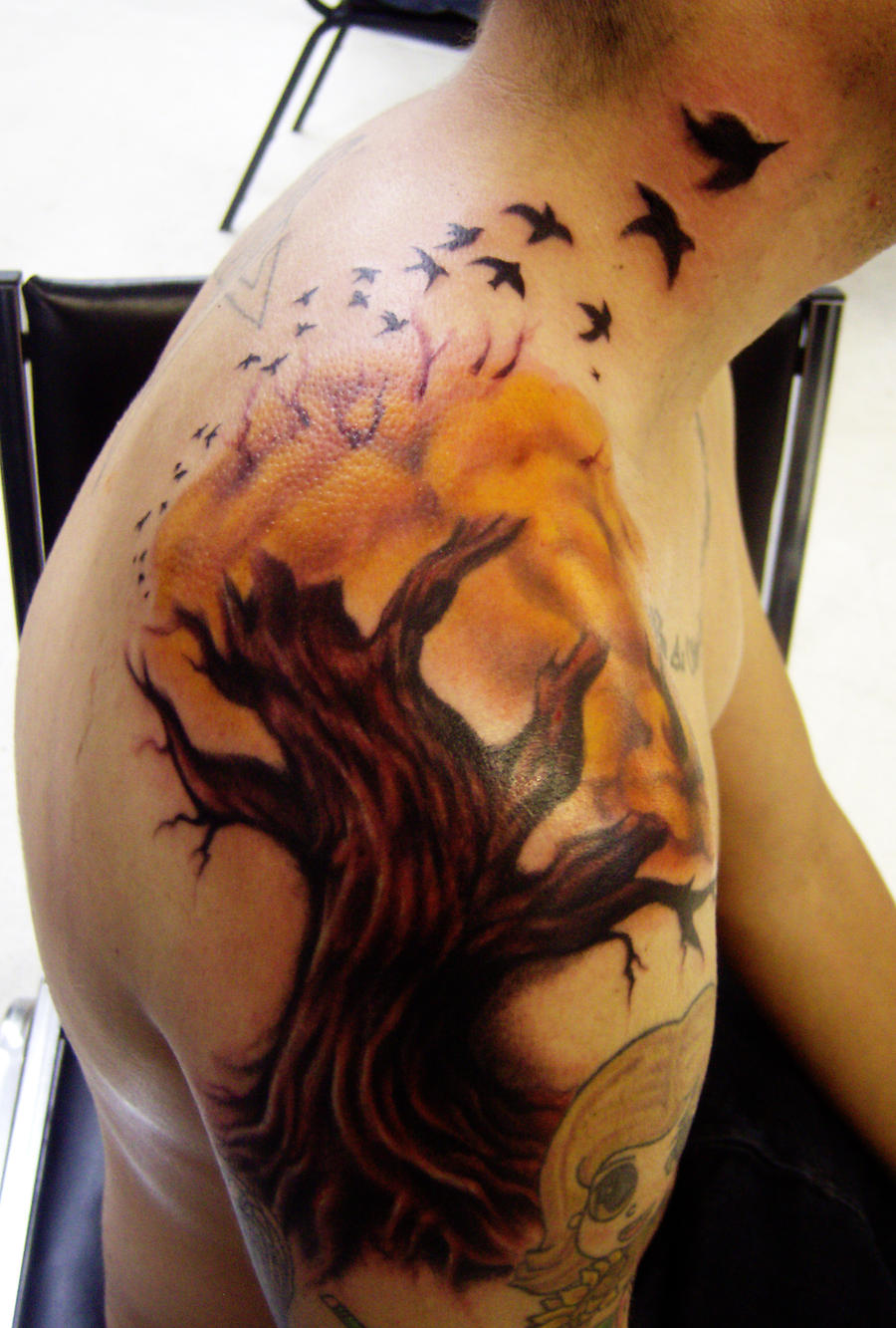tree tattoo with birds