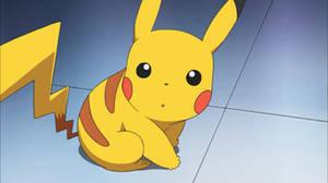Pikachu looking at his Poke Ball