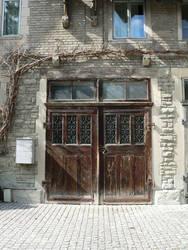 old ornate wooden door by clandestine-stock