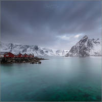 Norwegian landscape with cabins and a mountain