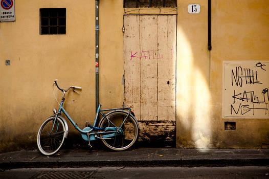 Blue bike on Florentine wall