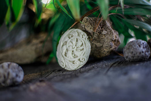 Carved bone Fern pendant