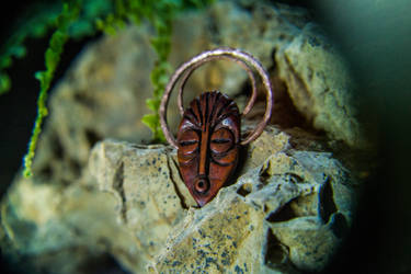 Mask pendant. Bone and copper