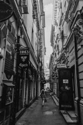 The walking through the small street. by modnikova