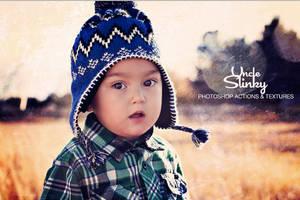 Boy in field by uncleslinky