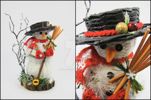 Snowman on a wooden log disc