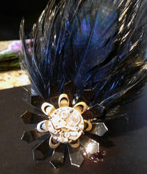 Clockwork flower hairclip with crow feather accent by lilvoodoo