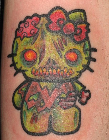 Pictures Of Hello Kitty Tattoos. hello kitty zomibe tattoo done