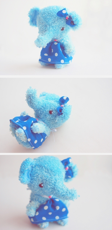 blue elephant with a bow by da-bu-di-bu-da
