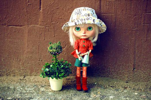 little gardener and her lovely plant