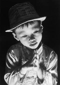 Pencil portrait of a little boy in Hoi An