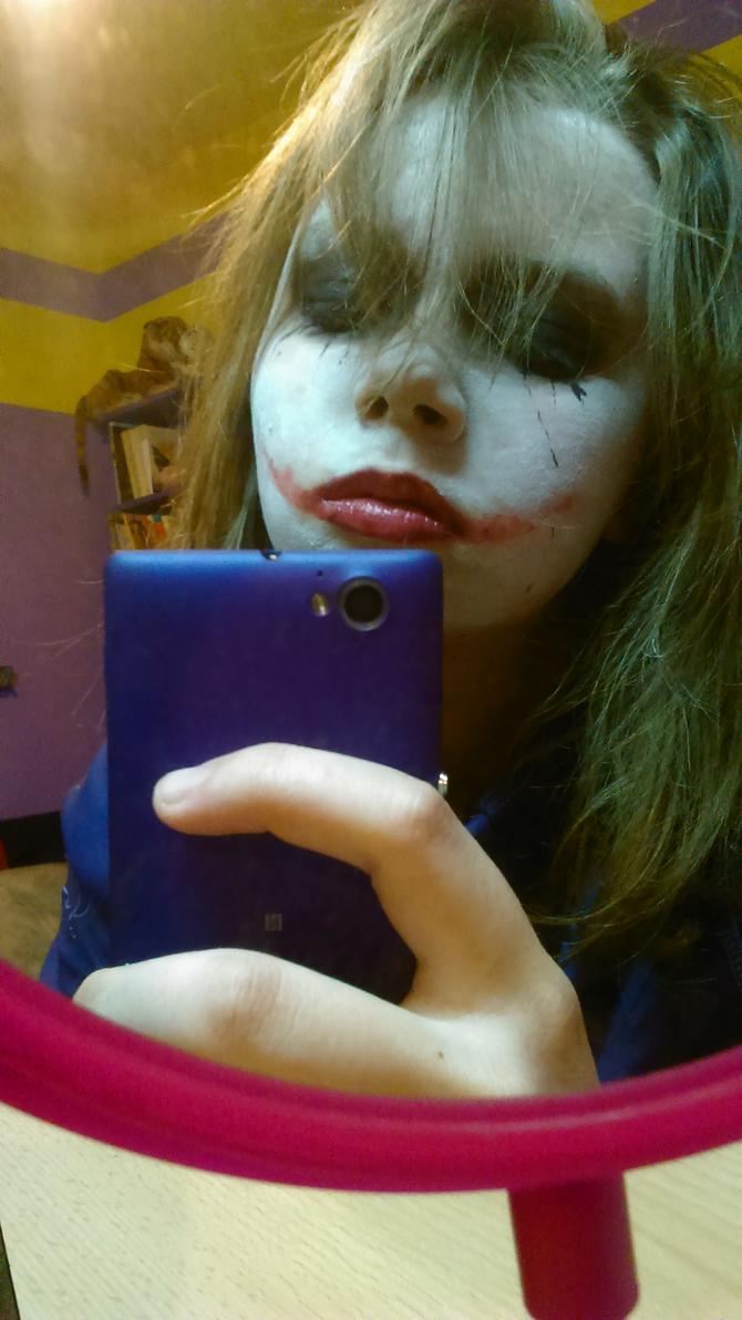 Sad Joker with a tiger plushie on a shelf by ZalyHeartlessTigress